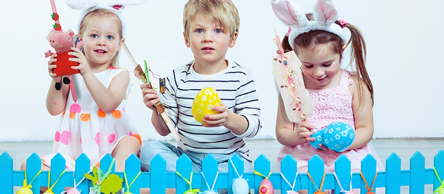 kids holding easter candles