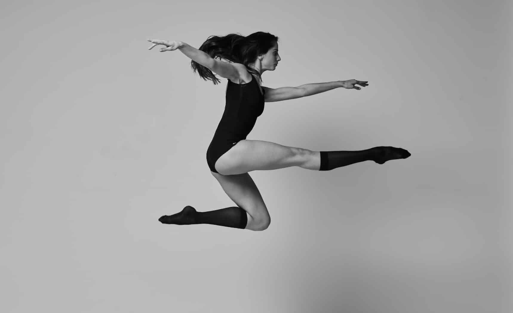 dancer black and whit wearing compression socks