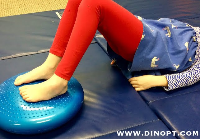 kids feet on tactile disc